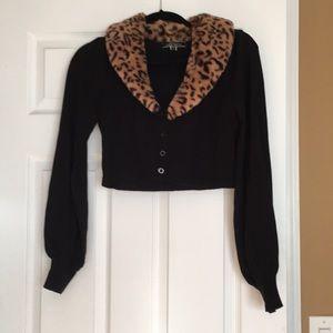 Black with cheetah print faux fur collar